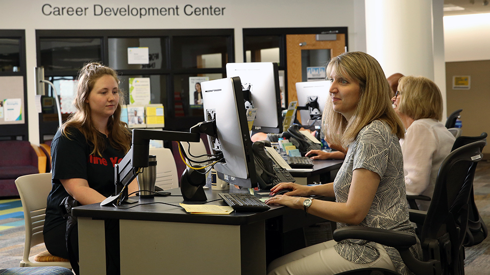 Two people sit at work stations in the Career Development Center, which is in the Student Success Center