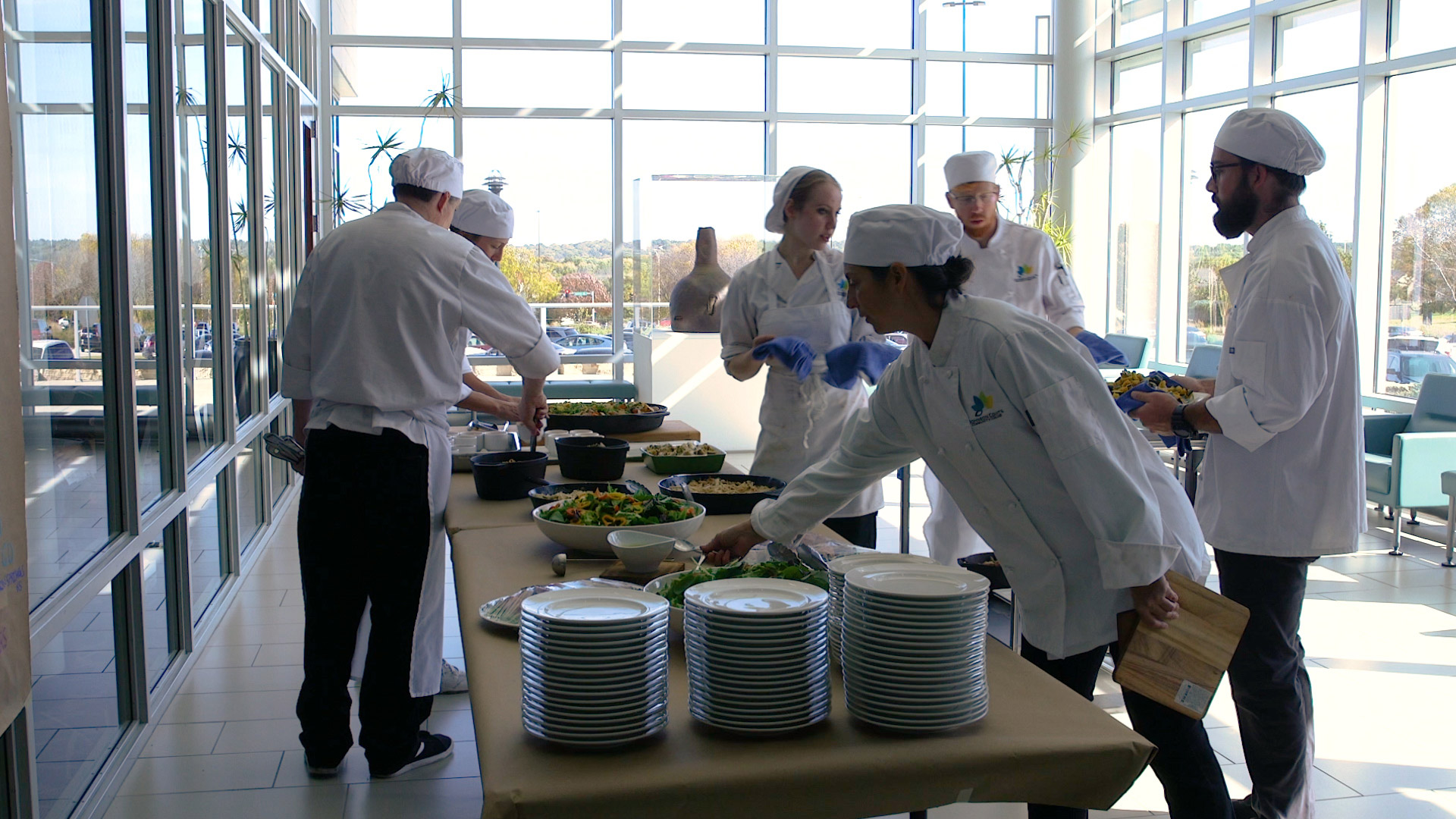 Culinary students setting tables