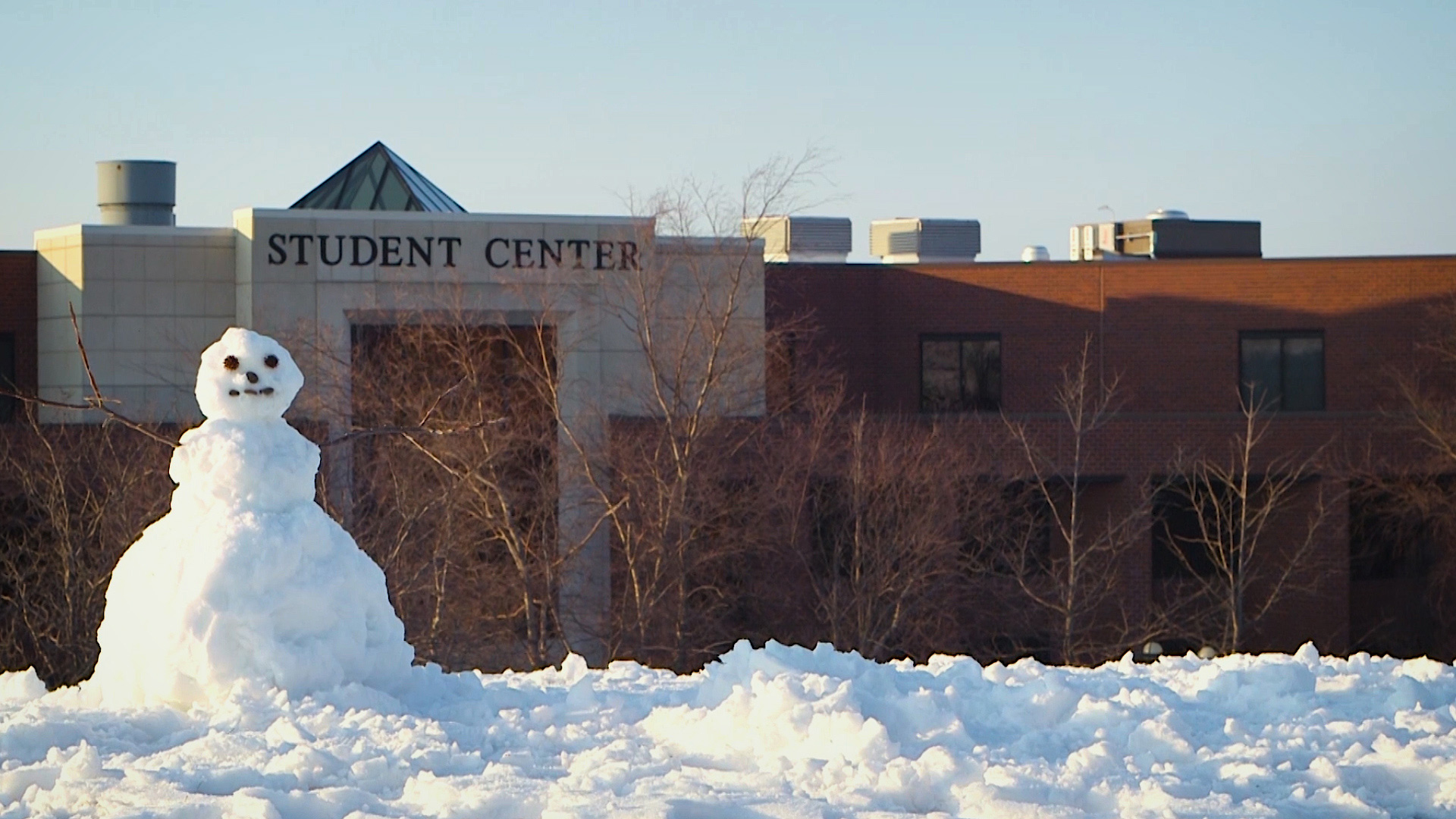 Front of the Student Center with a snowman in the foreground