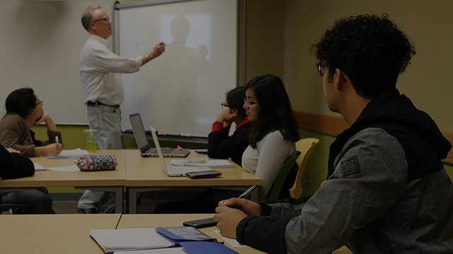 Faculty member Dennis Arjo lectures to his Philosophy students