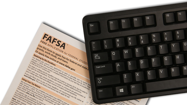 FAFSA form next to a computer keyboard