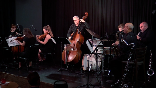Promotional image of a string quartet playing with a jazz quartet.