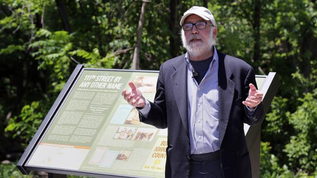 Henry Fortunato giving a talk in front of a historical marker on the Indian Creek Bike and Hike Trail.