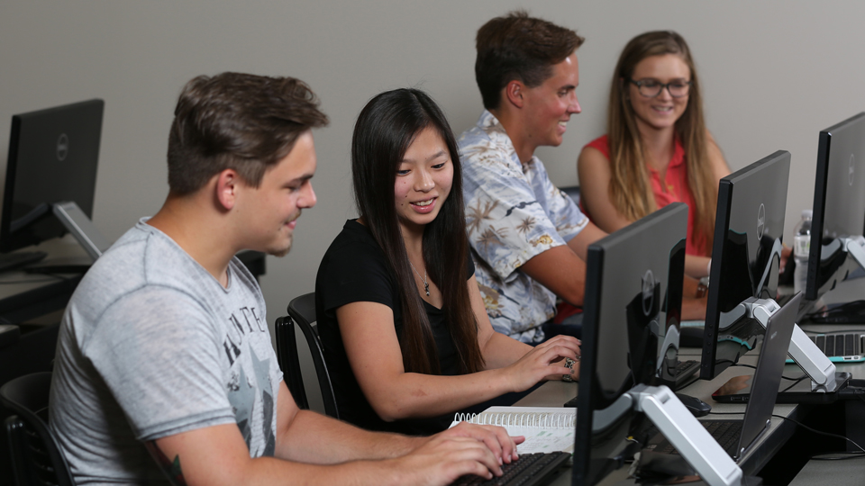 College Now Students Taking A Computer Class