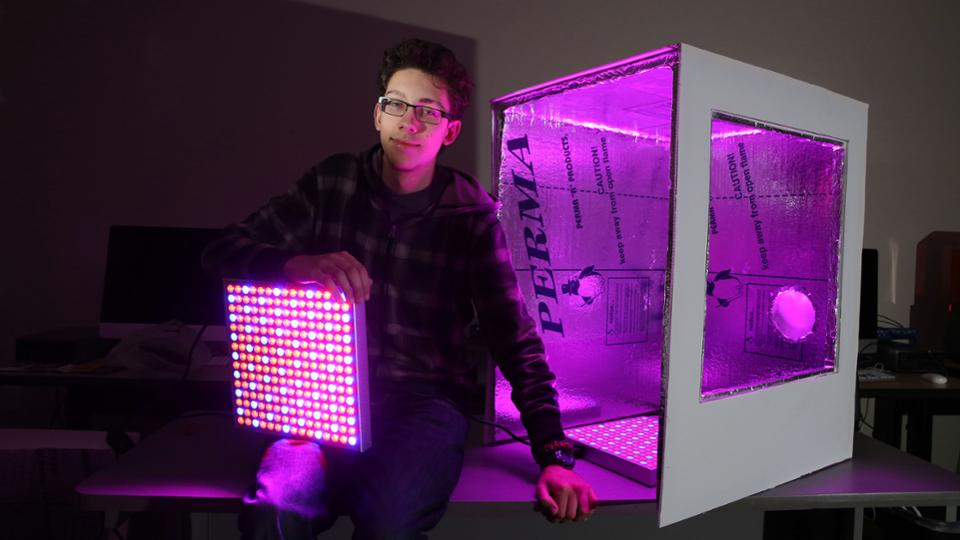 Ben Carpenter poses in front of his food computer prototype model