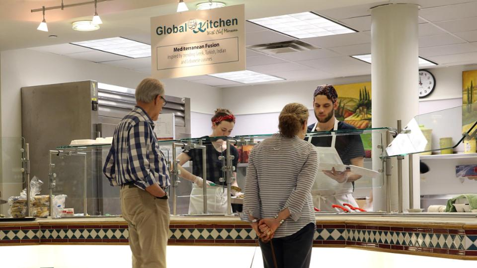 Two customers examining the options at the Global Kitchen in the basement of the COM building