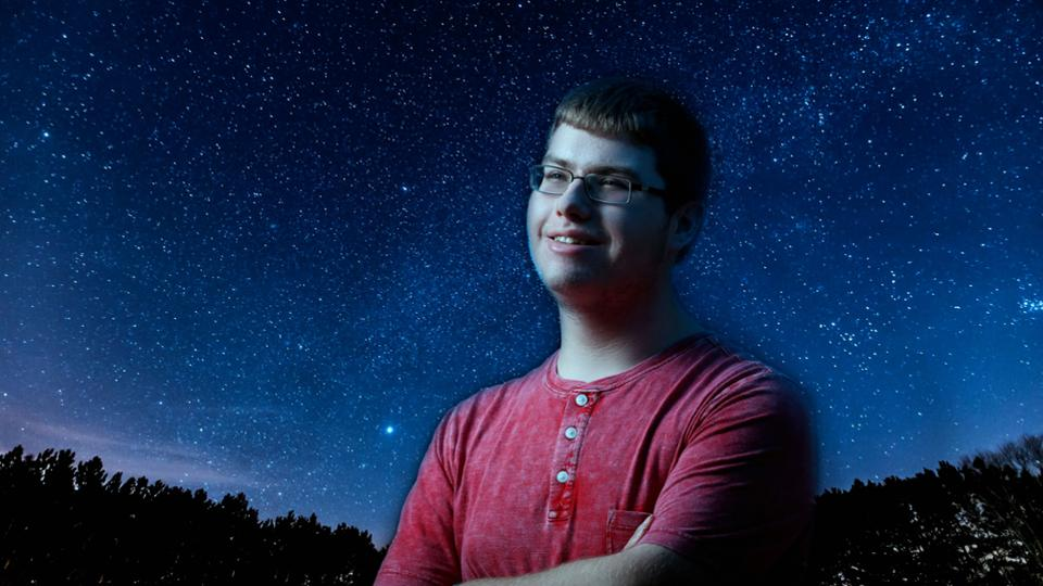 Image of Jack Conners standing against a starlit night sky