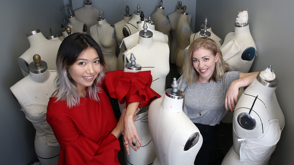 JCCC faculty Jill Patton and student Munisa Khuramova pose amid a group of dressmaker dummies.