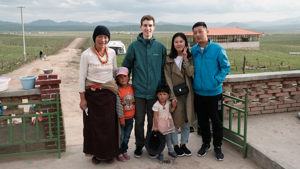 Andrew Hartnett poses with the family who hosted him in China